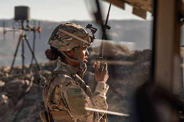 A soldier uses a communications intelligence (COMINT) radio system