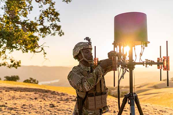 A soldier adjusts a communications monitoring device